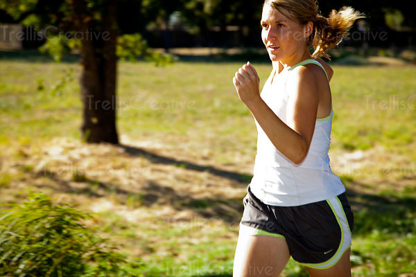 Focused female athlete running in the park