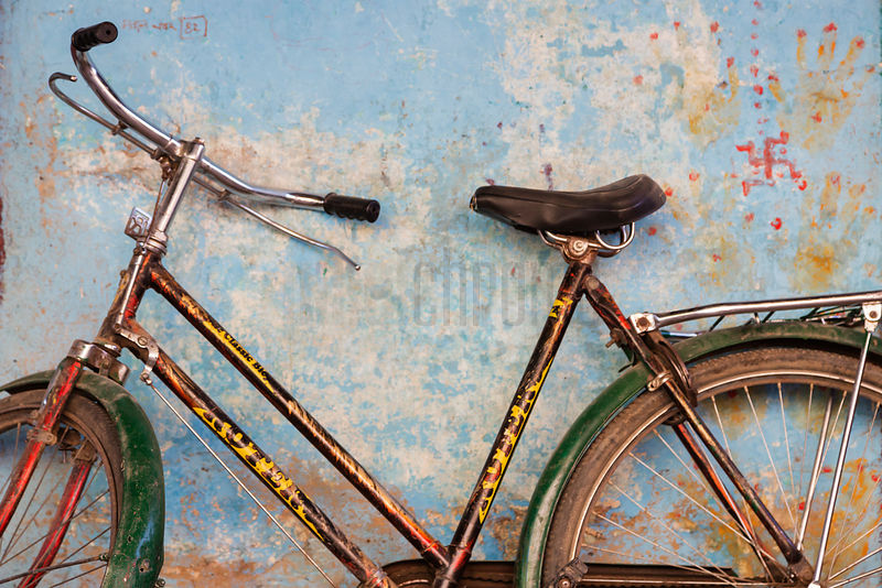 Bicycle Leaning Against a Blue Wall