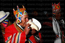 Aymara shaman or amauta blowing conch shell at start of Aymara New Year celebrations, Tiwanaku, Bolivia