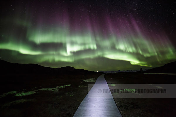 Northern Lights as seen from the boardwalk of the UNESCO World Heritage Ilulissat Icefjord