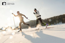 Two cross country skiers at the Stazersee. Switzerland.