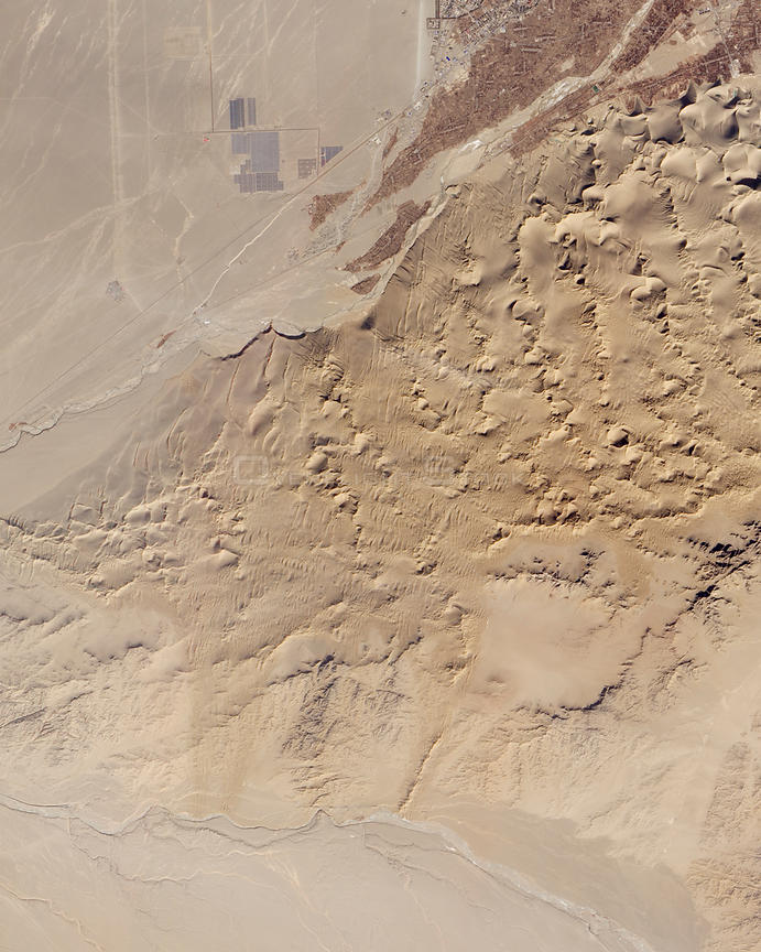 In northwestern China, near the ancient Silk Road outpost of Dunhuang, the sandy landscape sees little moisture but is no str...