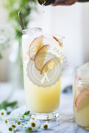 White Nectarine Prosecco Sangría with Ginger & Elderflower in a glass