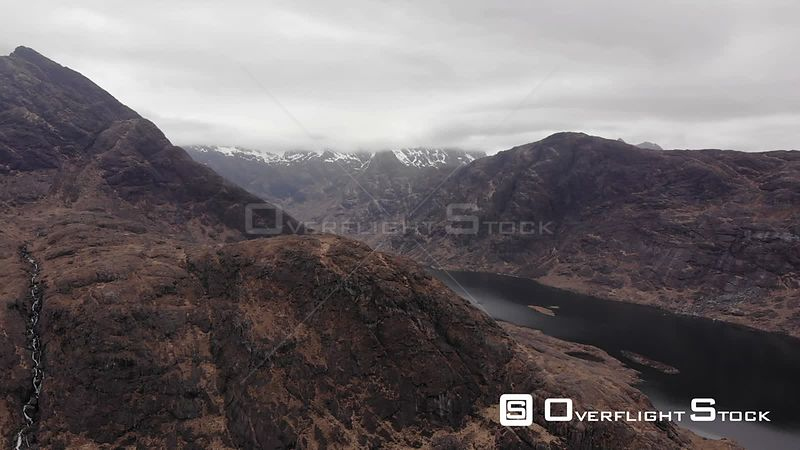 Aerial drone shot revealing Black Cuillin and loch Coruisk on Isle of Skye, Scotland