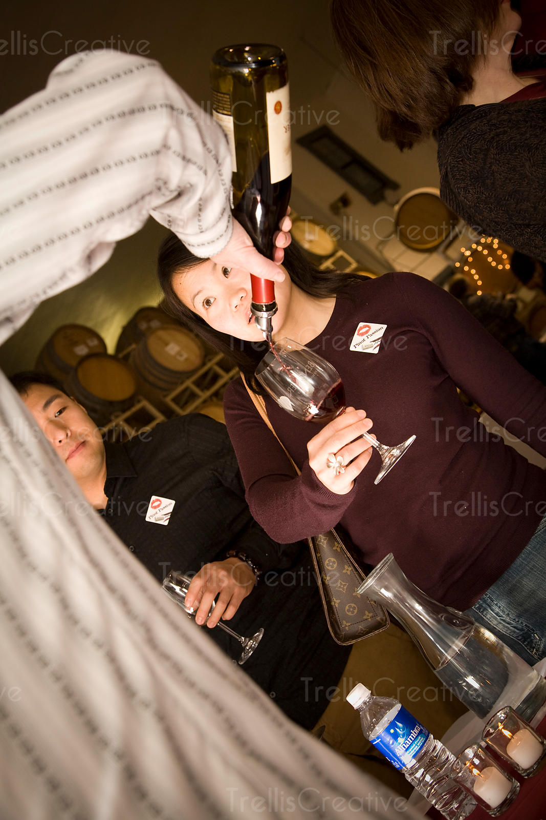 Red wine being poured for a young Asian woman