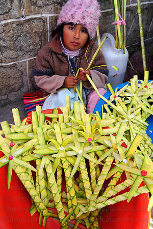 Girl selling crosses made out of palm leaves on Palm Sunday , La Paz , Bolivia