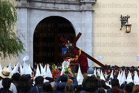 Penitents carrying statue of Señor de las Caidas / The Fallen Christ out of La Merced church at start of Good Friday processi...