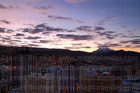 High rise buildings in Sopocachi at sunrise,  Mt Illimani in distance, La Paz, Bolivia
