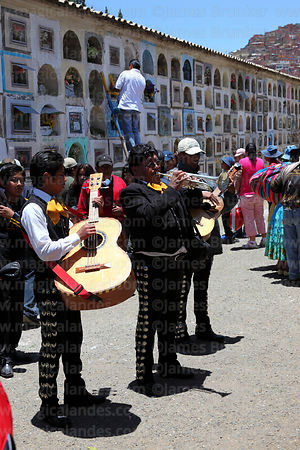 Mariachi musicians playing for souls of the deceased in cemetery during Todos Santos festival, La Paz, Bolivia