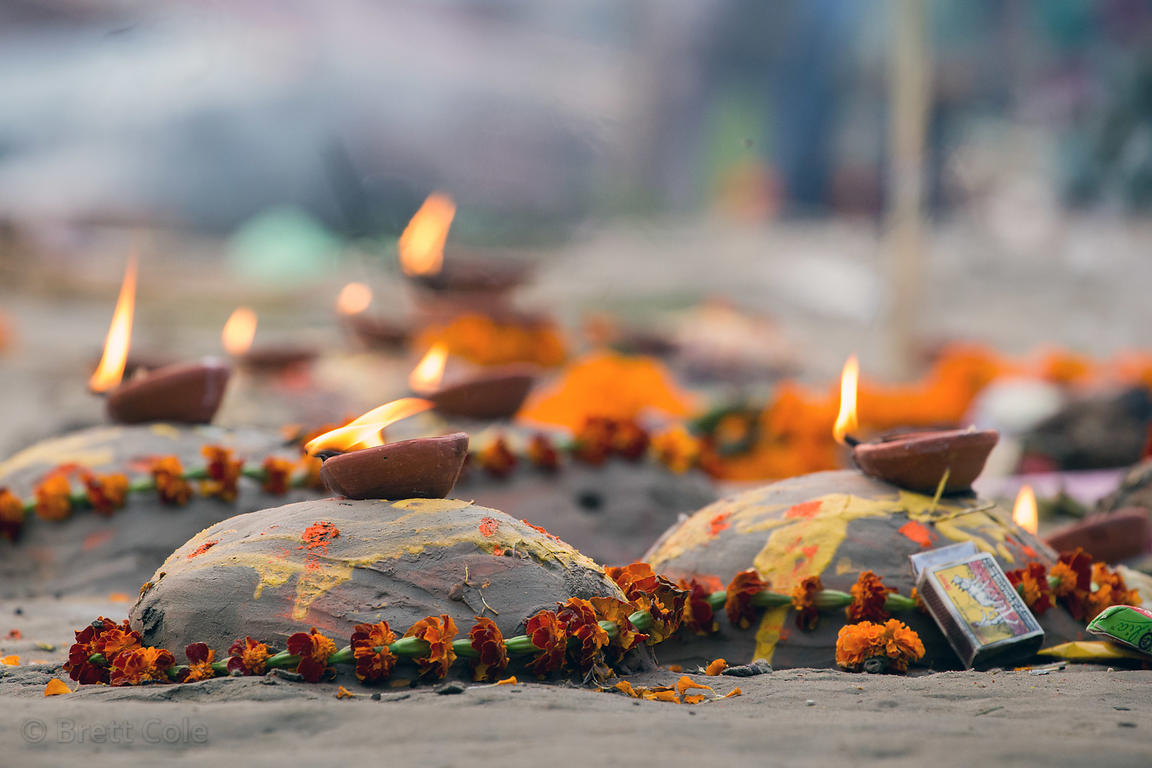 Prayer offerings on the Ganges River at Assi Ghat, Varanasi, India