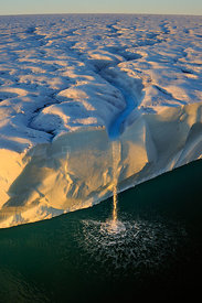 Waterfall from ice cliffs and polar ice cap. Austfonna Polar Ice Cap, Svalbard, Arctic. August 2011. Highly commended in the ...