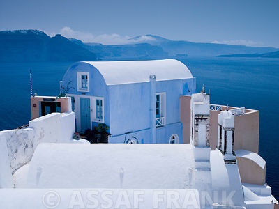 A house pained in ligth blue on the Oia cliff in Santorini Greek Isle.