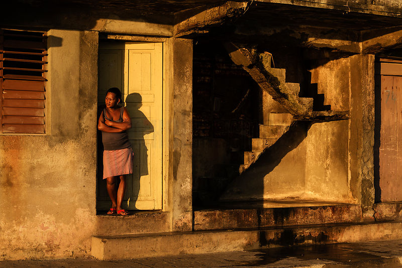 Woman Standing Outside Her Front Door in the Early Morning Sun
