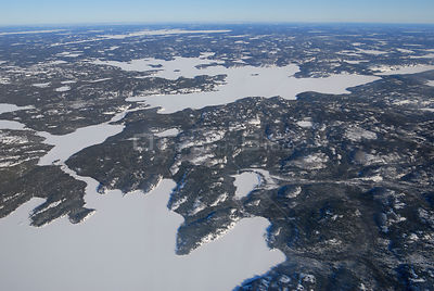 Aerial view of taiga forest and frozen lakes in winter, Northwest Territories, Canada March 2007