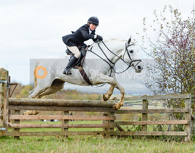 Alice Robb jumping a hunt jump at Stone Lodge. The Cottesmore Hunt at Tilton