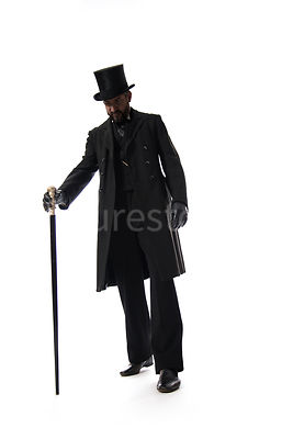A Victorian man in a hat and coat, walking with a cane – shot from low level.