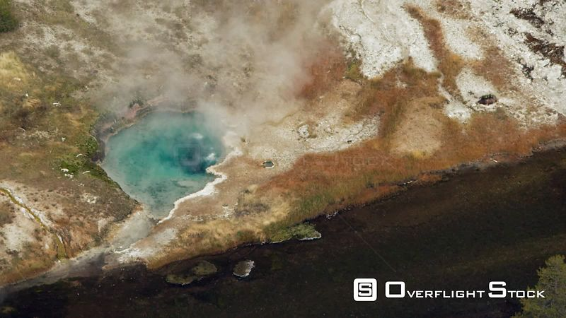 Colorful thermal pools and geysers sit near the Firehole River in the Upper Geyser Basin of Yellowstone National Park