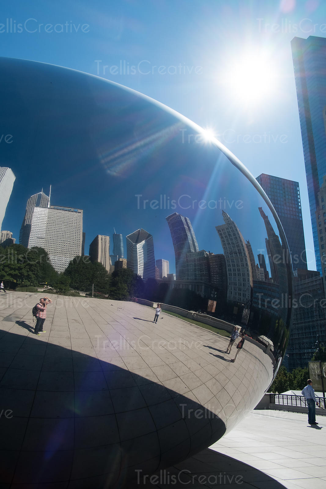 Reflection of city skyline on the Cloud Gate sculpture in downtown Chicago, Illinois