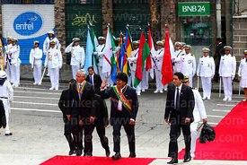 Bolivian president Evo Morales Ayma (centre) and vice president Alvaro Garcia Linera (left) arrive for official events for Di...