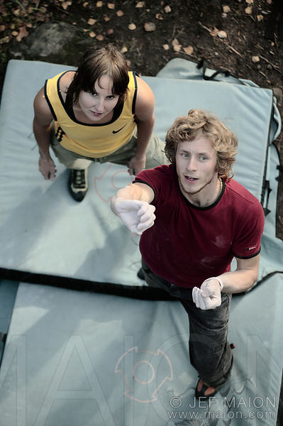 Rock climber studying climbing route