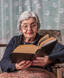 Portrait of an Old Woman Reading
