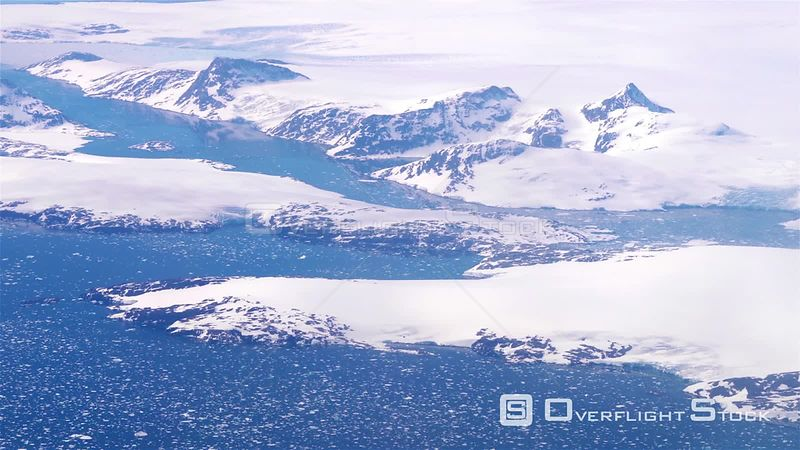 Mountain fjords and ice sheet glacier breaking into ocean, Greenland