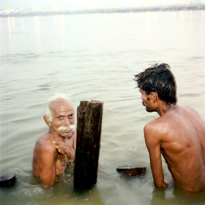 A pilgrim washes himself in the Ganges as an act of religious purification