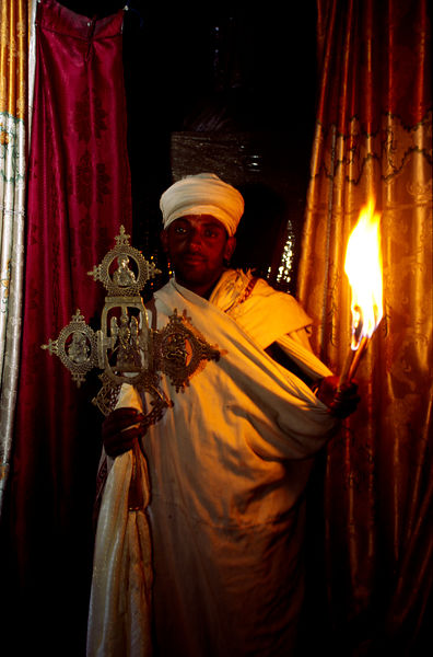 Ethiopia - Lalibela - A Ethiopian priest at the cave monestery of Yemrehama Kristos