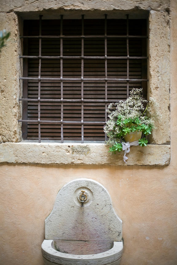 Italy - Verona - Detail of a sink and a flower pot in the Duomo