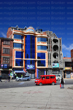 "Completed and partially built ""cholet"" building side by side in Villa Adela district, El Alto, Bolivia"