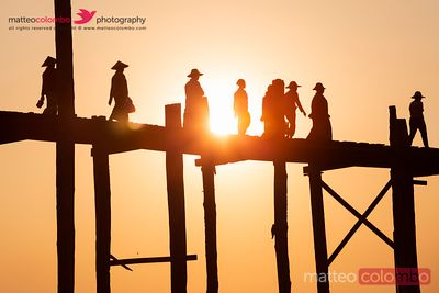 People walking on U Bein bridge at sunset, Mandalay, Myanmar