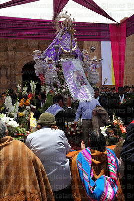 Devotees paying respect to Virgen de la Candelaria after central mass, Puno, Peru