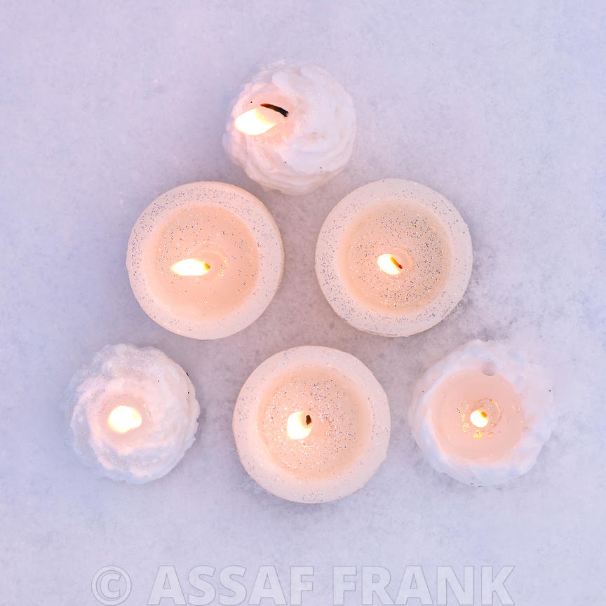 Christmas candles in snow