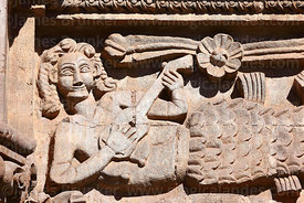 Detail of mermaid playing a charango or guitar on main facade of cathedral, Puno, Peru