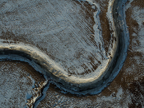 Aerial photo of a curved river eroded by glacial waters in Iceland