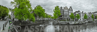Amsterdam cityscape with houses along water canal