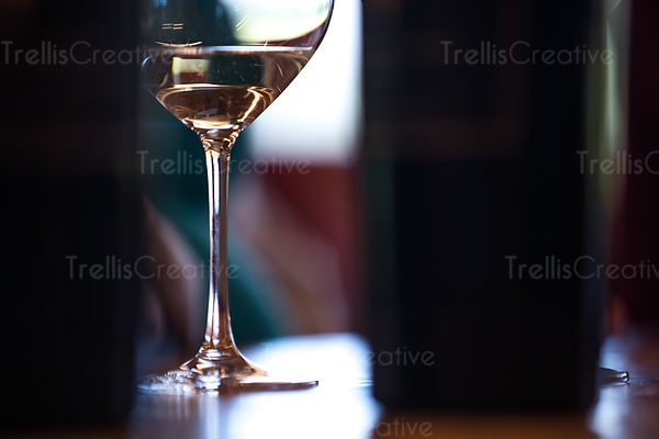 Close-up of white wine glass on table