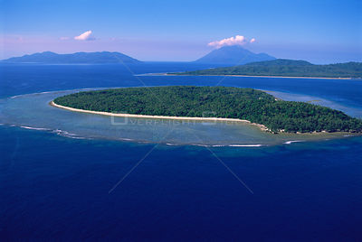 Aerial view of Lamen Island with fringing reef, high volcanic islands in background (Epi, Lopevi and Paama Is) Vanuatu, South...