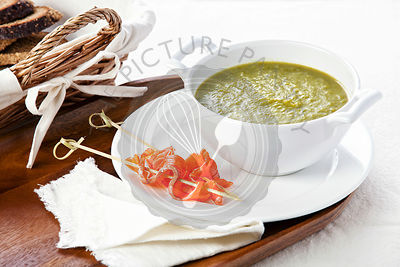 Asparagus soup with smoked salmon on white