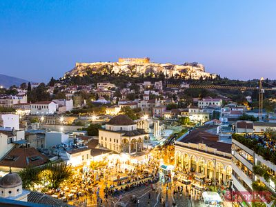 Elevated view of city and Acropolis at dusk. Athens, Greece