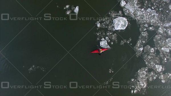 Kayaker on the Fraser River in Winter Ice Canada