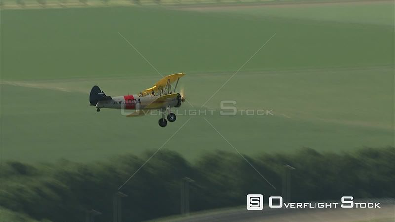 Airtoair view of US Navy biplane landing on a runway in The Netherlands