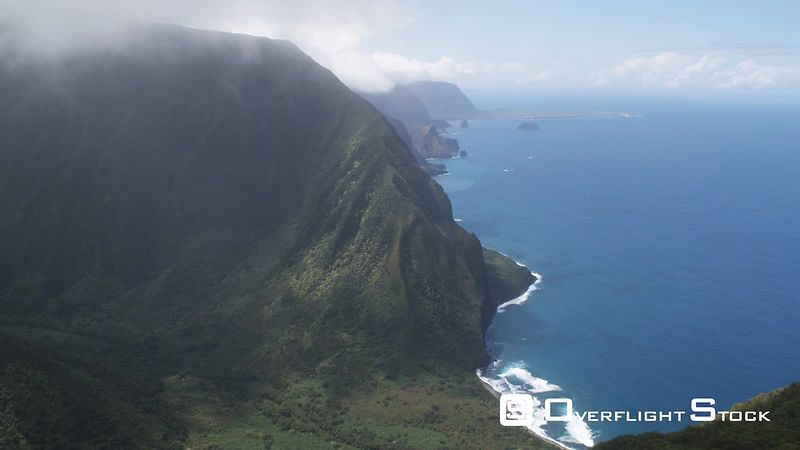 Over wooded hills to wide view of the Molokai coastline.