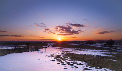 Sunset and snow near Bretton, Peak District