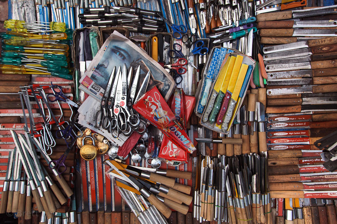 Top-down view of cutlery for sale at Crawford Market, Mumbai, India.