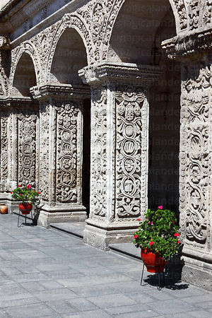 Pillars and geranium in cloisters of La Compañia de Jesus church , Arequipa , Peru