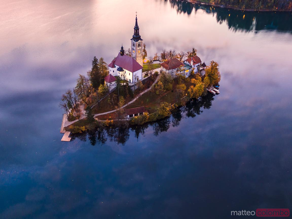 Aerial drone view of Bled island at sunset, Slovenia