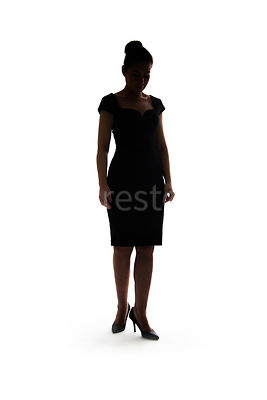 A woman, in silhouette, walking towards camera – shot from mid level.