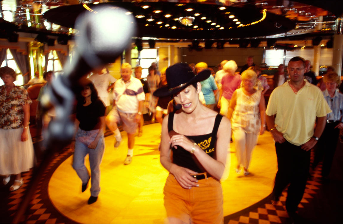 Passengers dance at a line dancing party on board the P&O Cruise Liner Oriana
