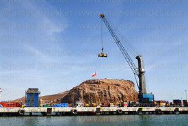 Cranes and containers in port and El Morro headland, Arica, Region XV, Chile